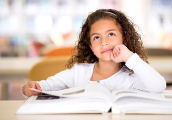 Thoughtful girl reading a book