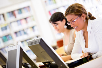 Female students researching at the library