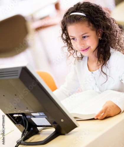Schoolgirl working on a computer