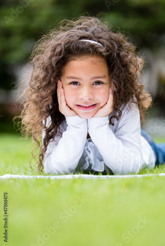 Little girl studying outdoors