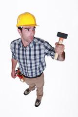 Man curiously looking at hammer