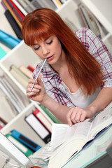 Redhead studying hard for her exams