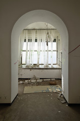 abandoned building, arched door
