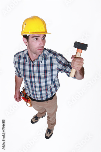 Man curiously looking at hammer
