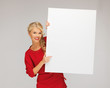 lovely woman in red dress with blank board