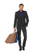 handsome man in suit with shopping bags