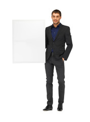 handsome man in suit with a blank board