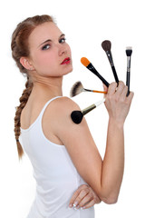 a woman showing some make-up pencils