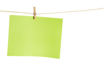 Sheet of paper with space for copy text, hanging from a rope wit