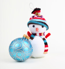 Christmas ball and snowman on white