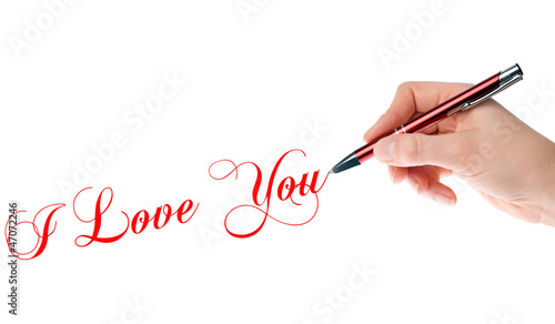 Hand with pen writes I Love You