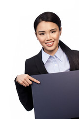 Asian businesswoman pointing to a board