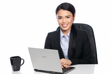 Successful Asian businesswoman at her desk