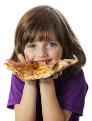 a little girl eating a pizza