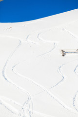 Snow background with ski and snowboard tracks