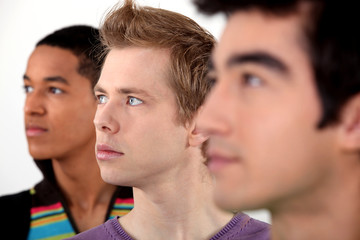 Three young men in profile