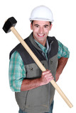 Cheerful worker with a sledgehammer