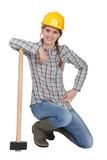 Famale laborer kneeling