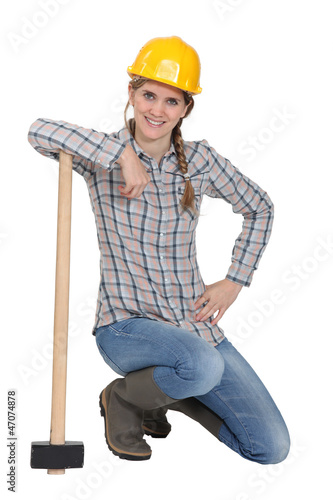 Famale laborer kneeling