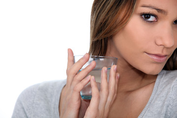 close-up of a woman with glass of water