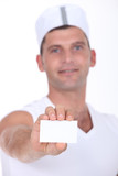 Chef holding businesscard