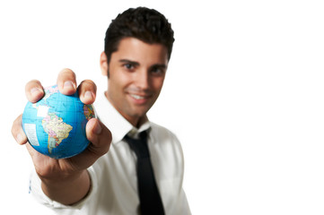 Business man holding the world in his hands