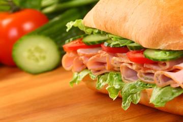 Fresh ham sandwich on wooden board