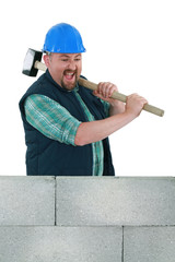 Angry builder about to smash wall
