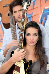 young woman and man playing in a music band