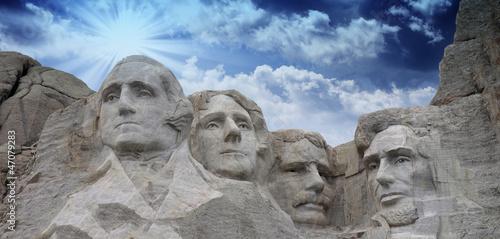 Leinwanddruck Bild Colors of the sky above Mount Rushmore - South Dakota