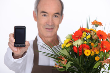 a florist showing a cell phone