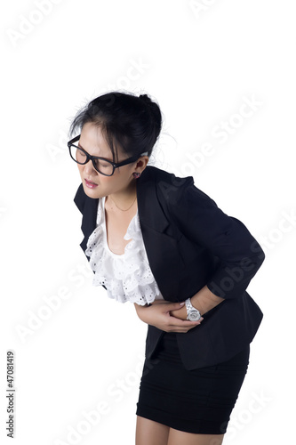 Business woman suffers from stomachache