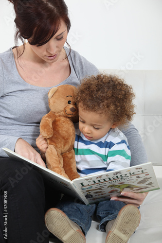 A mother reading to her son.