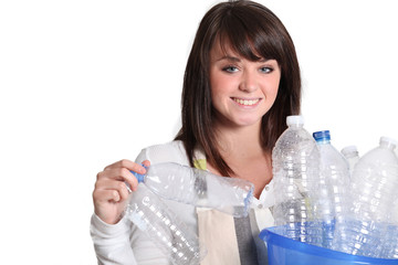 woman gathering bottles