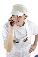 Female decorator contacting customer via telephone