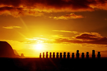 Mysterious stone statues at sunrise in Easter Island