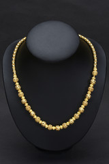Beautiful golden necklace designed in Thai ancient pattern