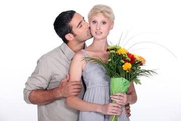 Husband kissing wife