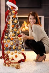 Happy woman with design christmas tree