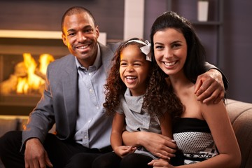 Portrait of happy diverse family at home