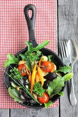 Summer vegetables baked in the oven in a pan