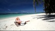 Woman relaxing on caribbean beach