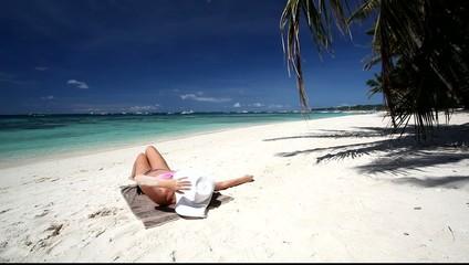 Woman relaxing on caribbean beach