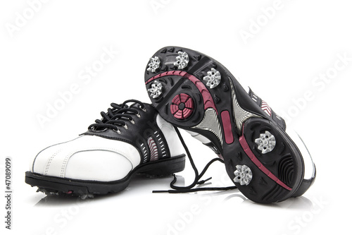 Ladies golf shoes isolated on white