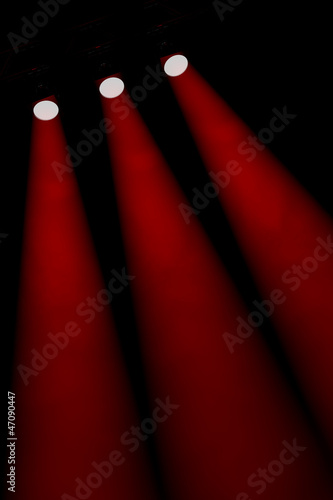 Three oblique individual red spotlight beams