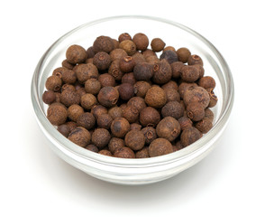 whole allspice berries in a glass bowl