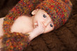 Newborn baby portrait in  woolen brown hat