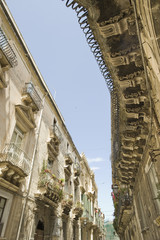 europe, italy, sicily, siracusa, baroque balconies in ortigia