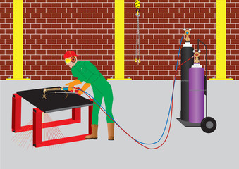 Man cutting steel with Oxy Acetylene Cutter