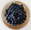 blue berries on the gold saucer